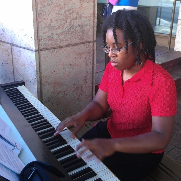 playing on an outdoor piano