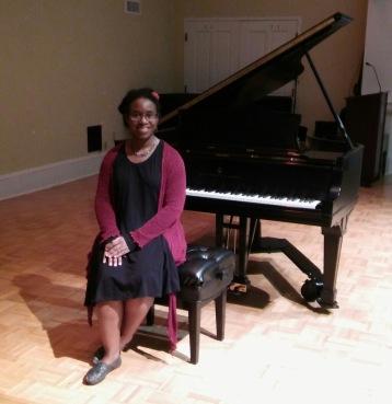 sitting at a piano